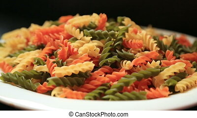 Colorful raw pasta in a plate