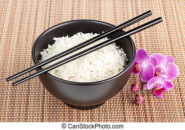 bowl of rice over a bamboo placemat