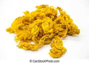 Yellow piece of Australian sheep wool Merinos breed close-up...