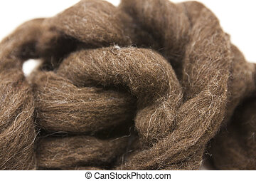 Brownpiece of Australian sheep wool Merino breed close-up on...