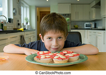 Boy with cupcakes