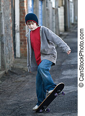 Boy skateboarding in an alleyway