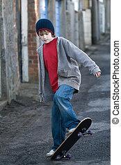 Boy skateboarding in an alleyway