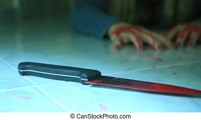 Woman hand holding knife with blood