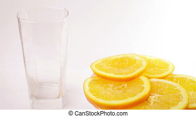 Orange juice pouring into glass