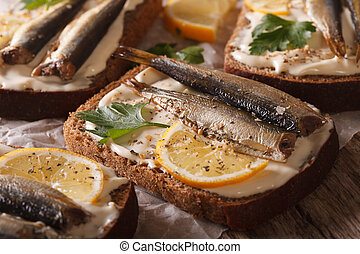 fish sandwiches with sprats, cream cheese and lemon macro...