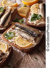 Tasty fish sandwiches with sprats, cream cheese and lemon...