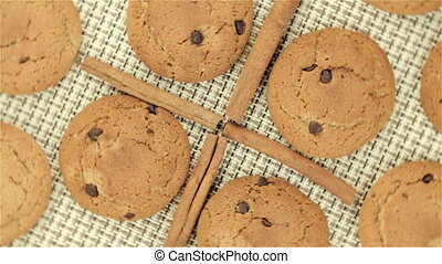 Rotating cookies and cinnamon on napkin, video