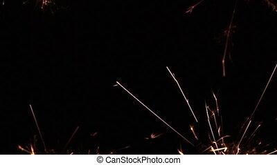 sparkler burning on blurry - sparkler burning on isolated...