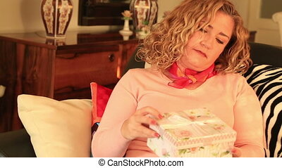 Woman opening the gift box - Portrait of beautiful excited...