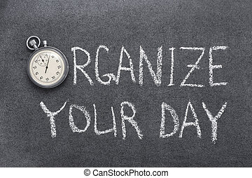 organize your day phrase handwritten on chalkboard with...