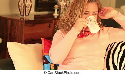 Woman relaxing indoor day dreaming - Smiling woman...