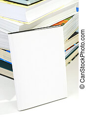 Blank book cover w background of pile of books