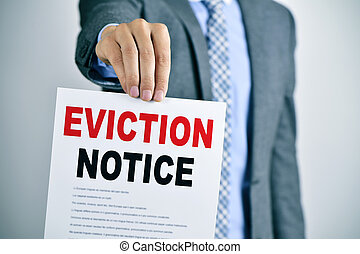 man with an eviction notice - a young caucasian man wearing...