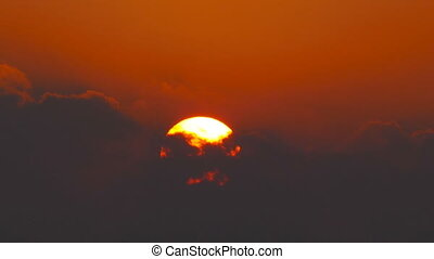 sun rising between clouds, telephoto, timelapse - great sun...