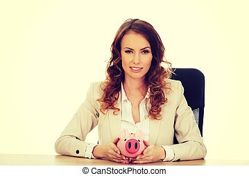 Business woman with a piggybank - Business woman with a...