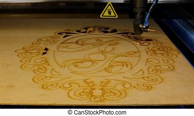 Laser machine cuts plywood pattern - Laser cutting machine...