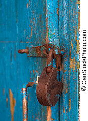 Old Padlock hanging on Door - Old padlock worn out by time...