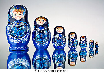 Babushka Nesting Dolls - A view of blue colored Russian...