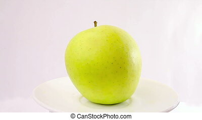 Green apple rotation on a white background