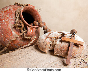 Communion still life - Antique wine jug, cross and rustic...