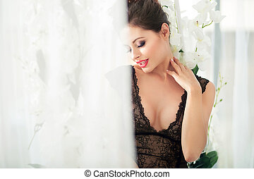 Portrait of a sensual young brunette lady