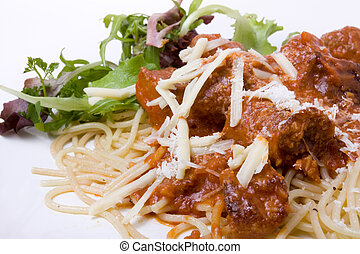 Home Cooked Meatballs with spaghetti and salad garnish