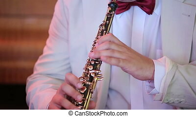 Musician playing the oboe closeup