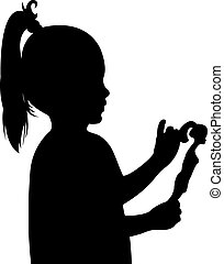 toddler child holding her toy baby