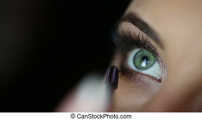 Mascara Applying Make Up of a woman