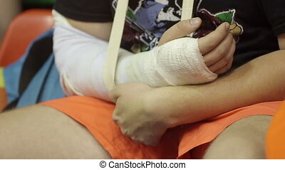 Child with a Broken Arm in a Gypsum