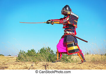 Man in samurai costume with sword. Samurai in ancient armor...