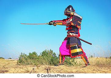 Man in samurai costume with sword. Samurai in ancient armor...