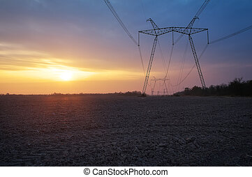 Electric power line and field at sunrise