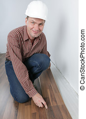 Man making the laminate flooring installation