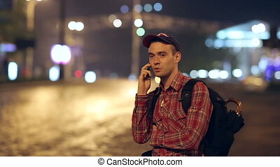 Backpacker Speaks by Phone - backpacker speaks on the phone...