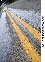 Double yellow line - An old background closeup texture of a...