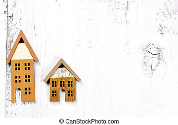 two little houses on wooden background - investment real...