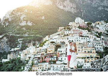 romantic young couple in honeymoon in Positano, Amalfi...