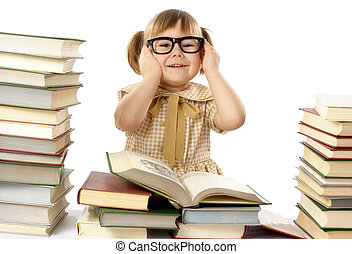Happy little girl with books wearing black glasses