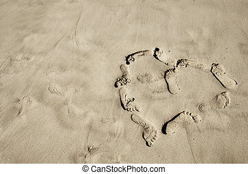 footprints heart - a heart made with footprints in the sand