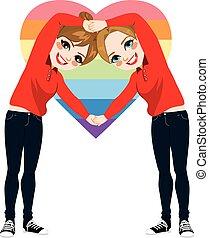 Women Heart Arms Symbol - Two beautiful young women making...