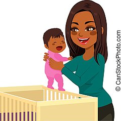 Young Mom Baby Crib - Beautiful young African American mom...