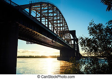 bridge  panoramic view at sunrise with warm sun light blue sky