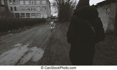 Girl goes on a dirt road camera follows her Black and white...