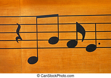 Musical Notes - Some musical notes on a wood background