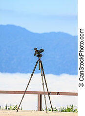Birdwatching monocular or spotting scope on a tripod in...