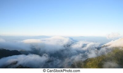 Clouds running over mountain. - Clouds running over mountain...