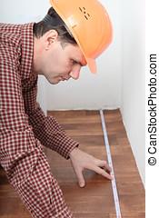 contractor measuring room
