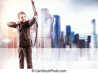 Targeting - Businessman with bow and city view background